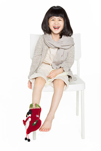 cute baby with christmas stockings stock photo