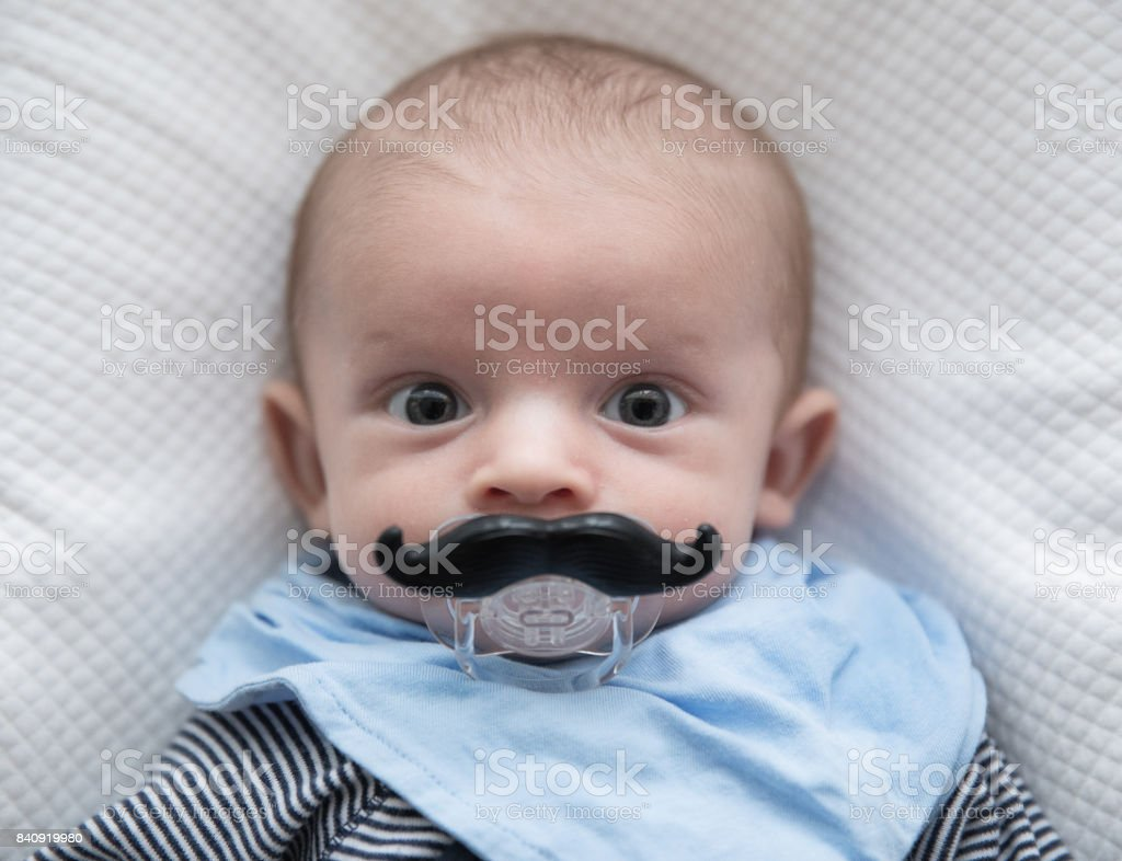 cute baby with funny mustaches stock photo