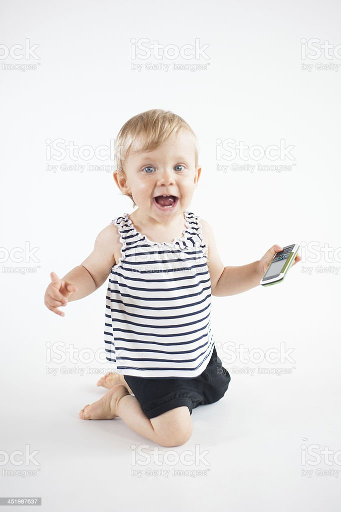 Cute Baby With Green Cell Phone Stock Photo More Pictures Of 12 17