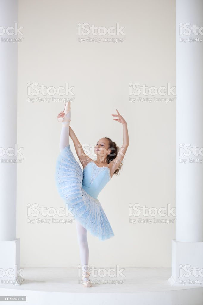 A Cute Ballerina In Ballet Costume And In Pointe Dances Near The Mirror Girl In The Dance Class The Girl Is Studying Ballet Ballerina Is Dancing The Dancer Is Training At The