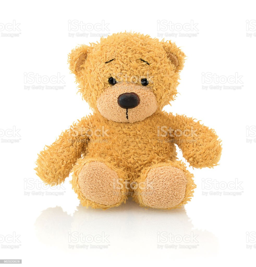 Cute bear doll isolated on white background with shadow reflection. Playful adorable bright brown bear sitting on white underlay. stock photo