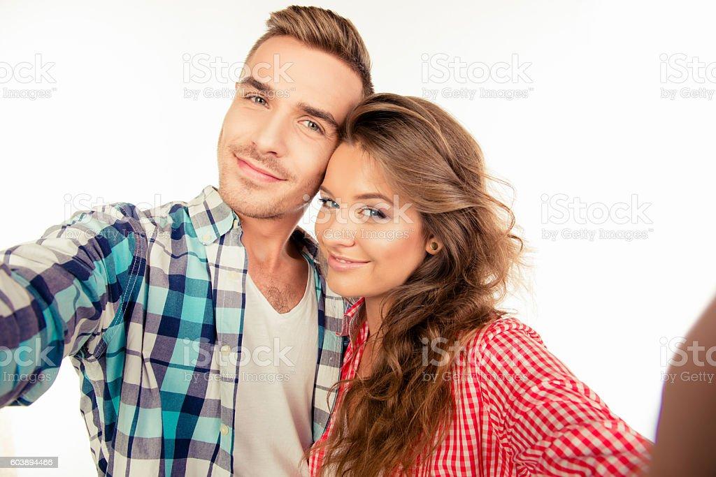 Cute beautiful cheerful couple  making selfie - foto de acervo