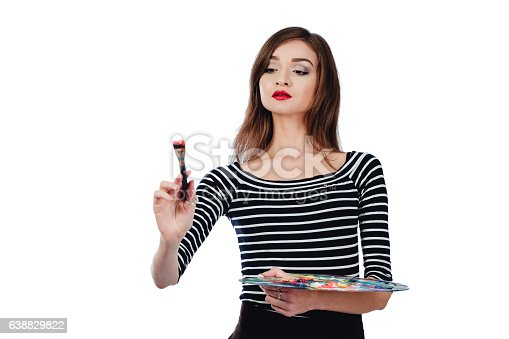 655303558 istock photo Cute beautiful girl artist holding a palette and  brush in 638829822