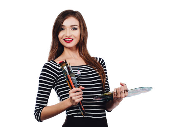 cute beautiful girl artist holding a palette and brush in - beautiful college girl pics stock photos and pictures