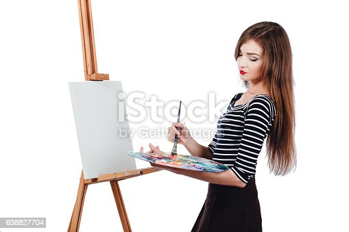 655303558 istock photo Cute beautiful girl artist painting a picture on  canvas  easel 638827704