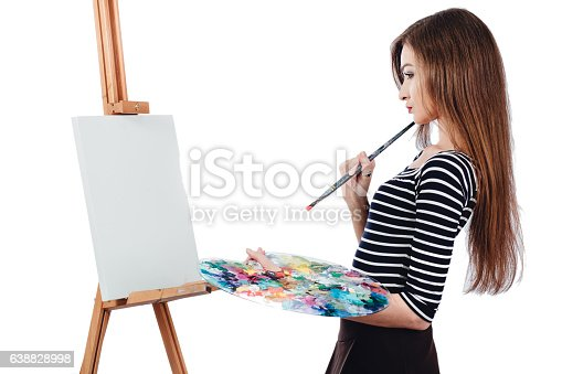 655303558 istock photo Cute beautiful girl artist painting a picture on  canvas  easel 638828998