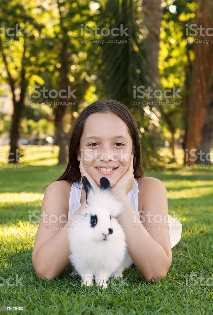 Cute Beautiful Smiling Teen Girl With Whiteblack Baby Rabbit Stock Photo Download Image Now Istock