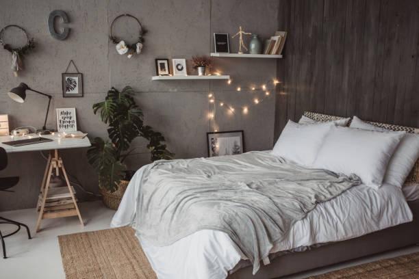 sevimli yatak odası - yatak odası stok fotoğraflar ve resimler