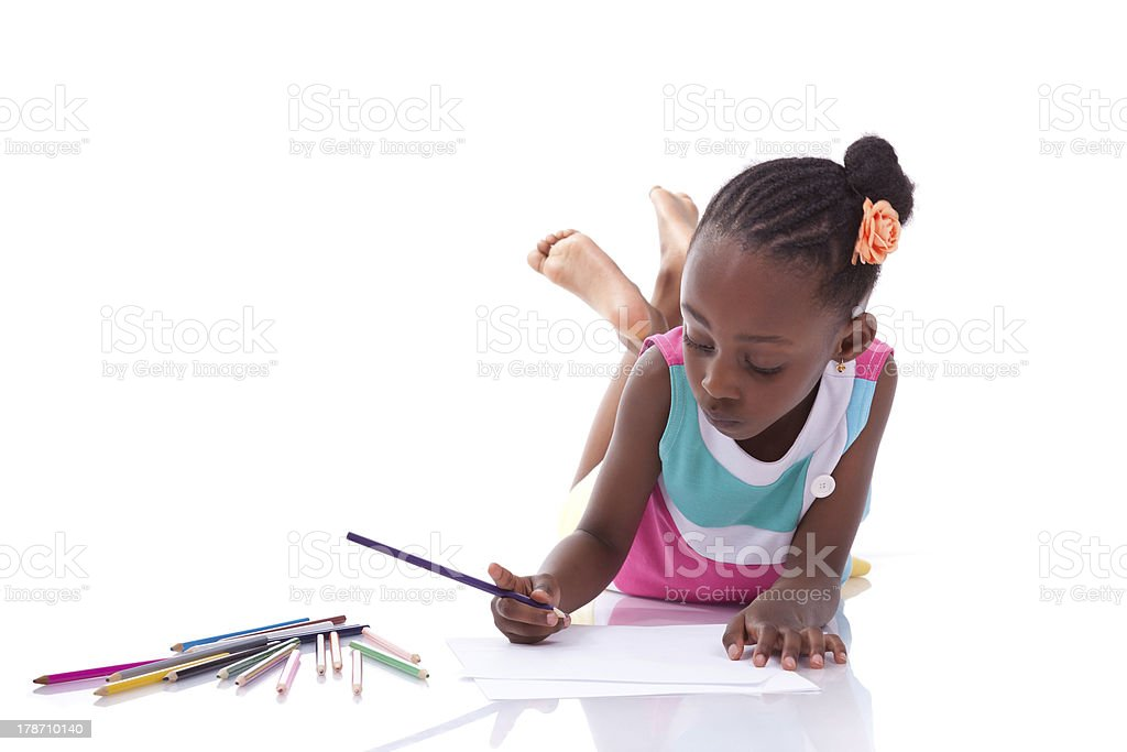 Cute black african american little girl drawing royalty-free stock photo
