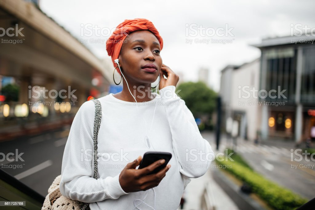 Cute black girl downtown stock photo