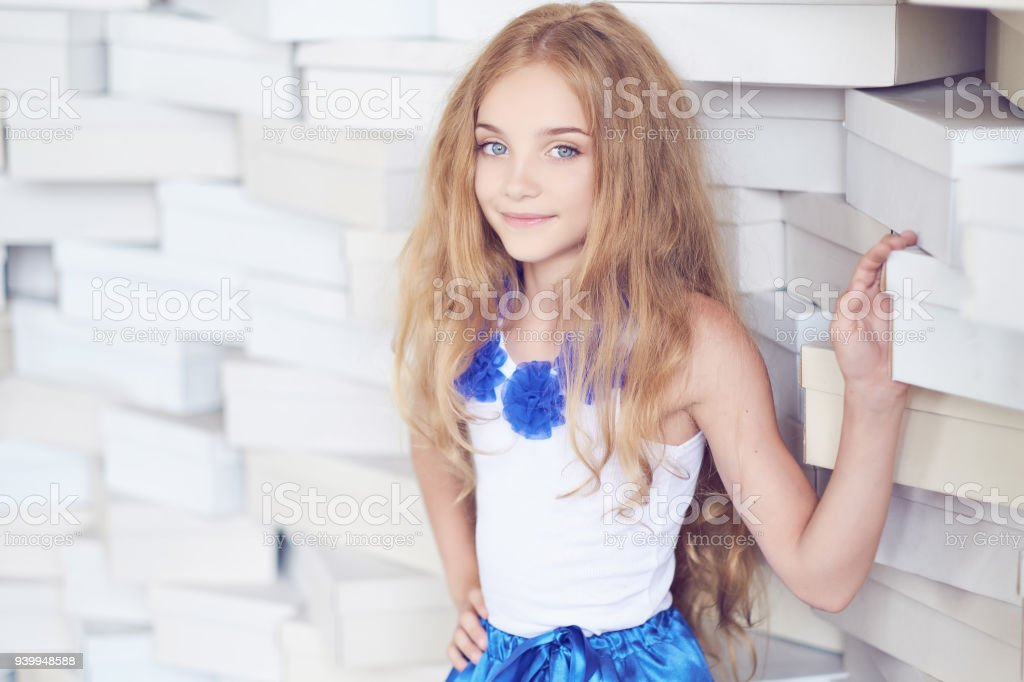 Cute Blond Teenager Female In A Blue Skirt Royalty Free Stock Photo