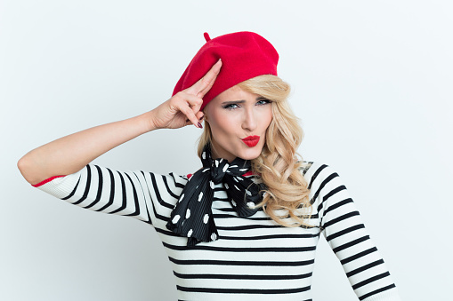 Cute Blonde French Woman Wearing Red Beret Saluting Stock Photo - Download Image Now