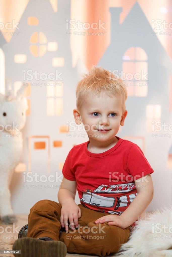 Cute Blonde Hair Little Boy Near Christmas Toy Paper Houses Stock