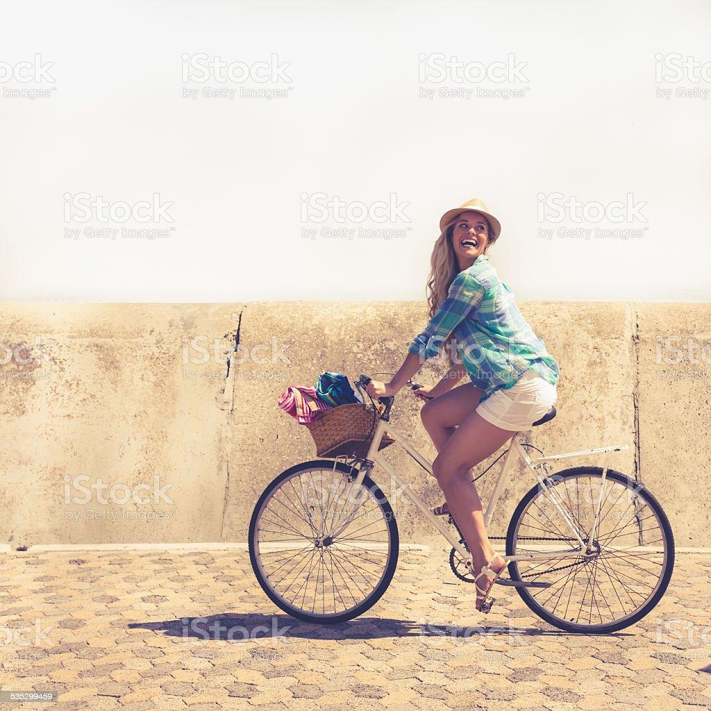 Cute blonde on a bike ride stock photo