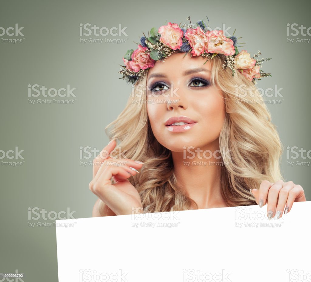Cute Blonde Woman with Blonde Curly Hair Holding White Paper Banner Background stock photo