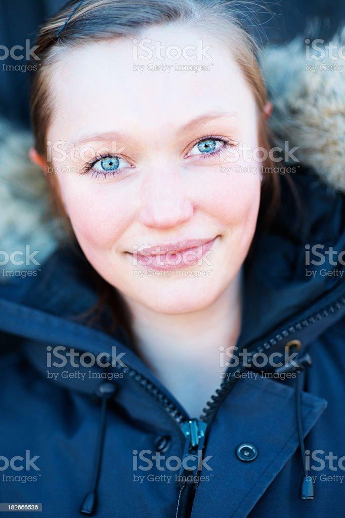 Cute blue eyed teen girl wearing winter jacket royalty-free stock photo
