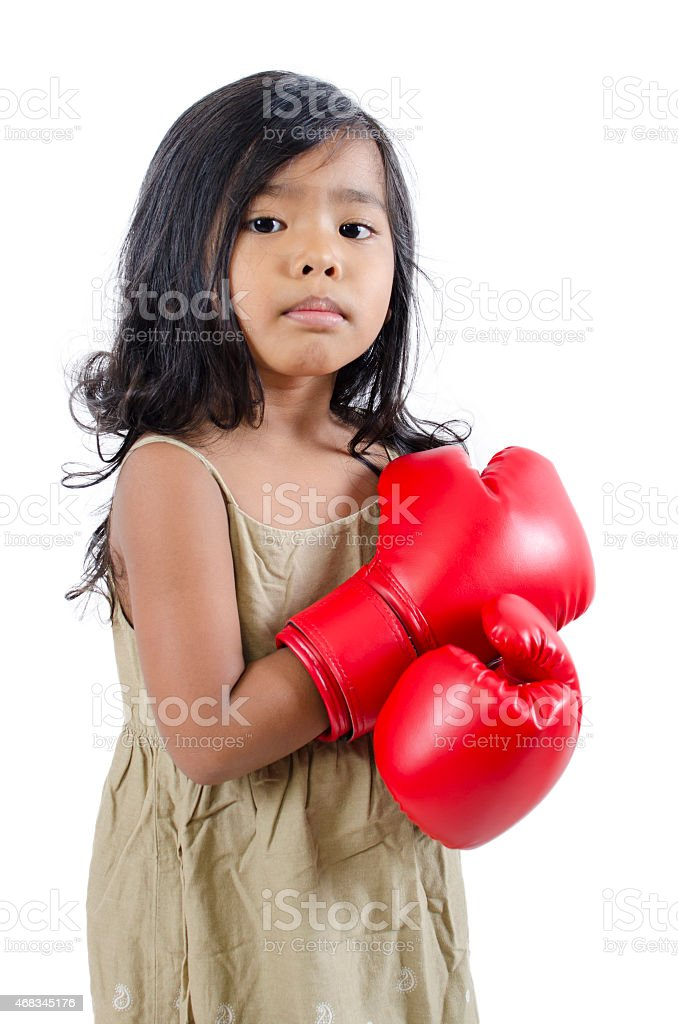 Cute boxer child wearing red boxing gloves royalty-free stock photo
