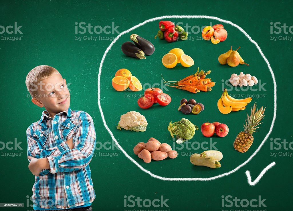 Cute boy and healthy food stock photo