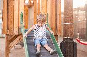 Sweet little boy is having fun at public park