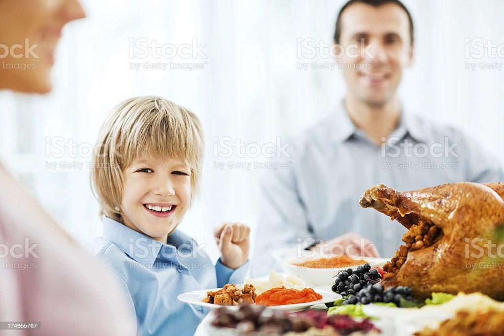 Cute boy at Thanksgiving dinner table. royalty-free stock photo
