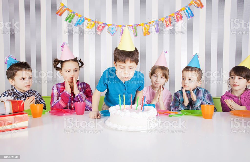 Pleasing Cute Boy Blowing Candles On Birthday Cake Stock Photo Download Birthday Cards Printable Nowaargucafe Filternl