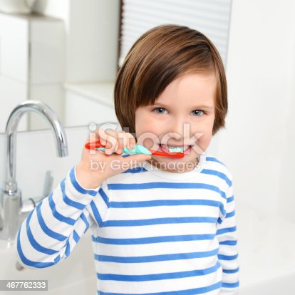 948443044 istock photo Cute boy brushing teeth. 467762333