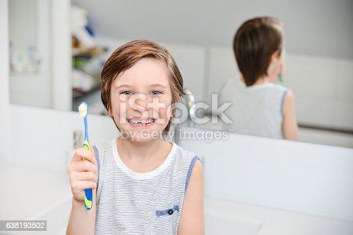948443044 istock photo Cute boy brushing teeth 638193502