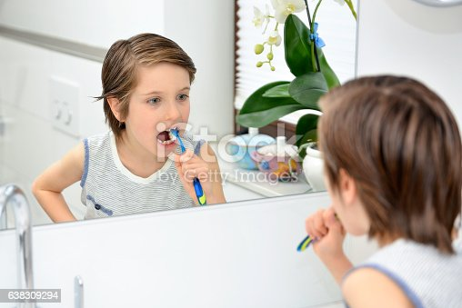 948443044 istock photo Cute boy brushing teeth 638309294