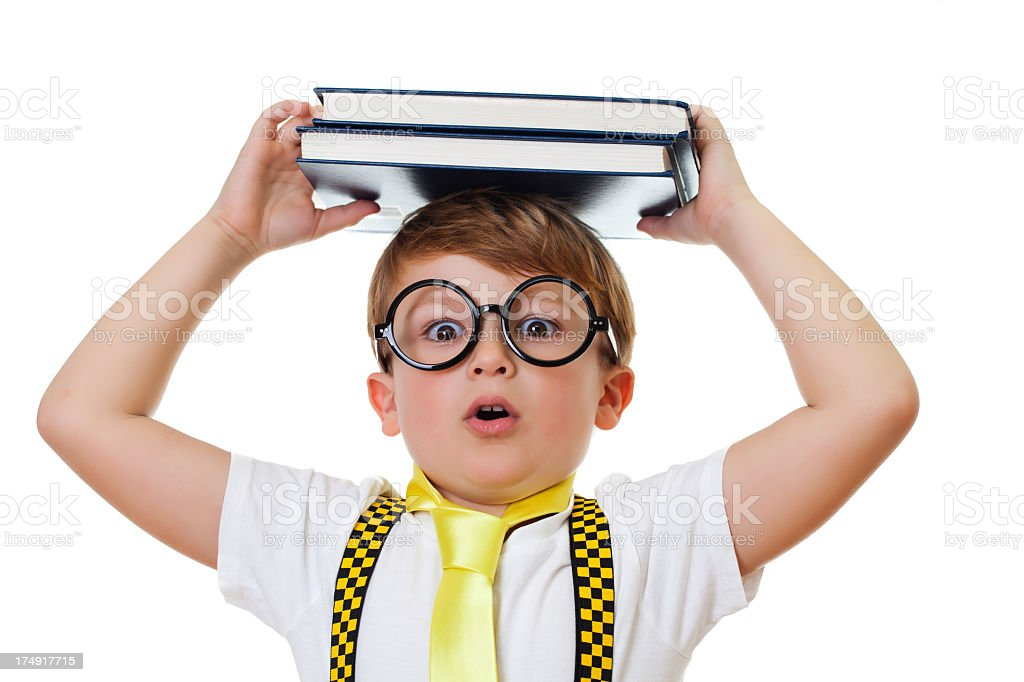 Cute boy carrying books on his head royalty-free stock photo