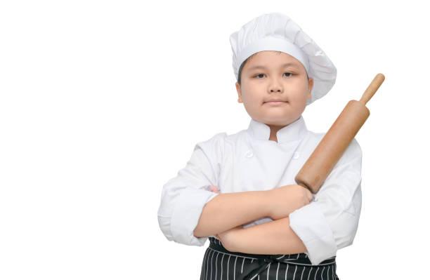 süße junge Chef halten Nudelholz mit Koch Hut – Foto