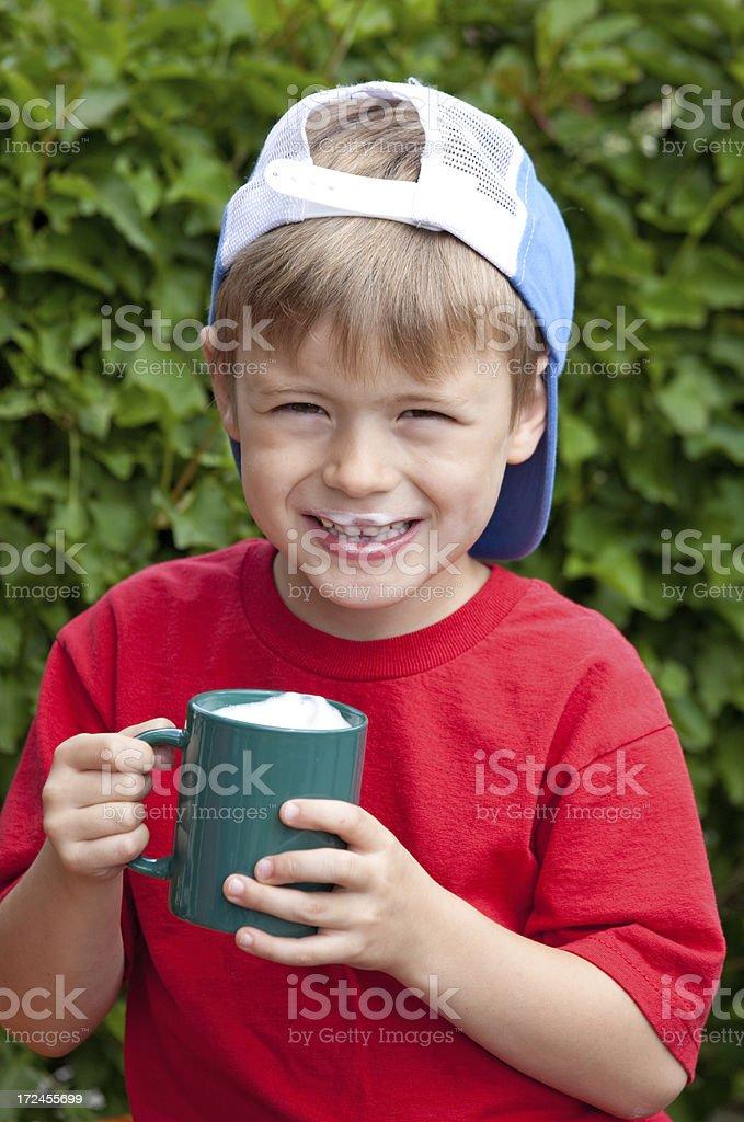 Cute Boy Drinking Hot Chocolate stock photo