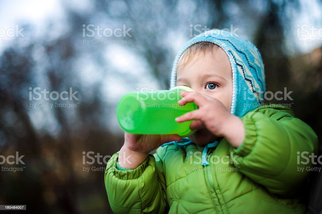Cute boy drinking stock photo