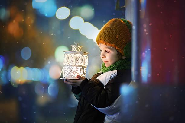 Cute boy, holding lantern outdoor stock photo