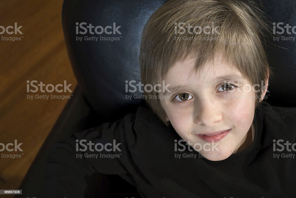 Cute boy in chair royalty-free stock photo