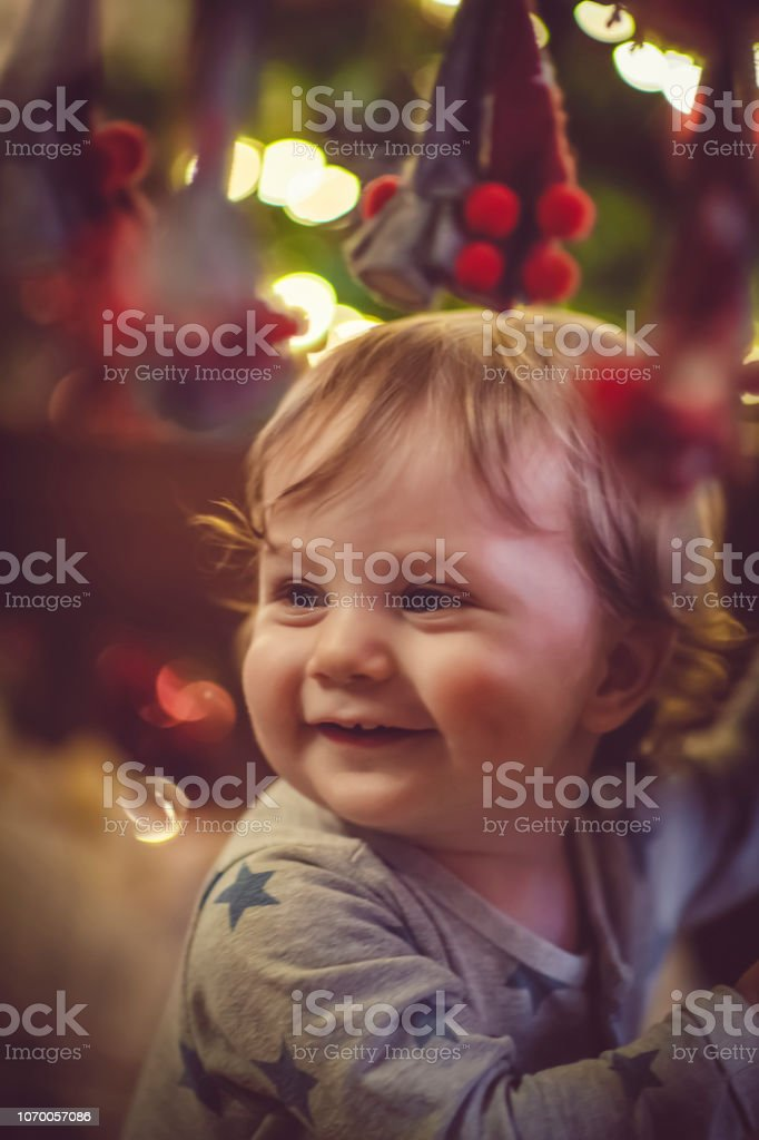 Cute boy in crib in Christmas stock photo