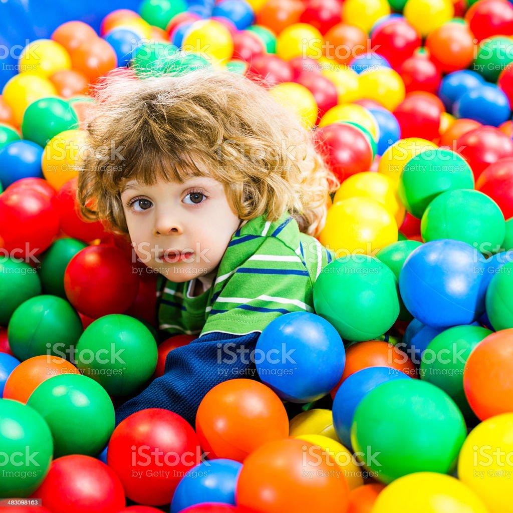 Cute boy in playroom. royalty-free stock photo