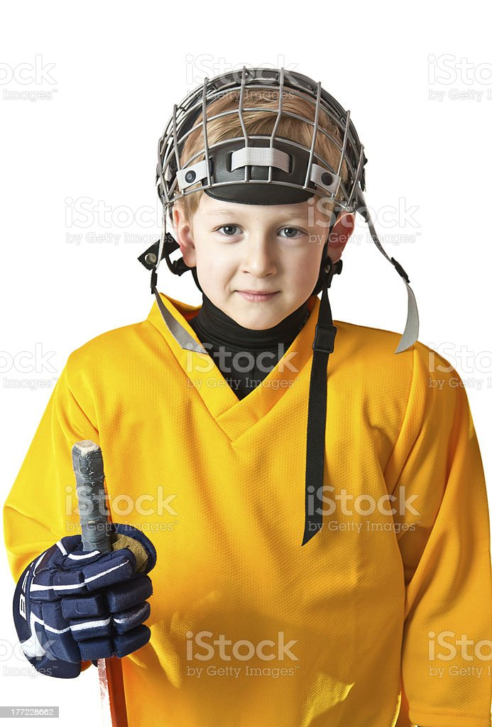 Cute boy in yellow hockey uniform royalty-free stock photo