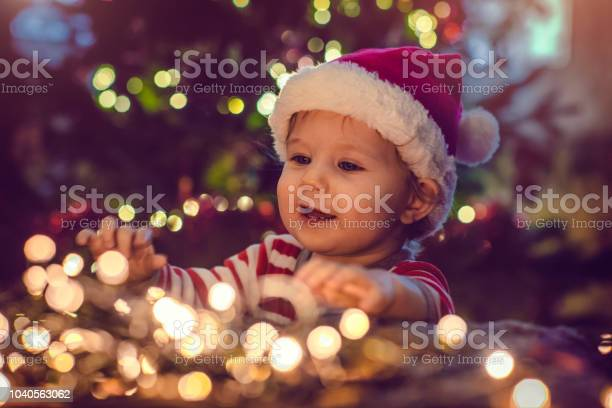Cute boy indoors near christmas tree picture id1040563062?b=1&k=6&m=1040563062&s=612x612&h=qgeq2utz7rumlceo7jay 6gxwhyis7vmrdzkumfyrga=