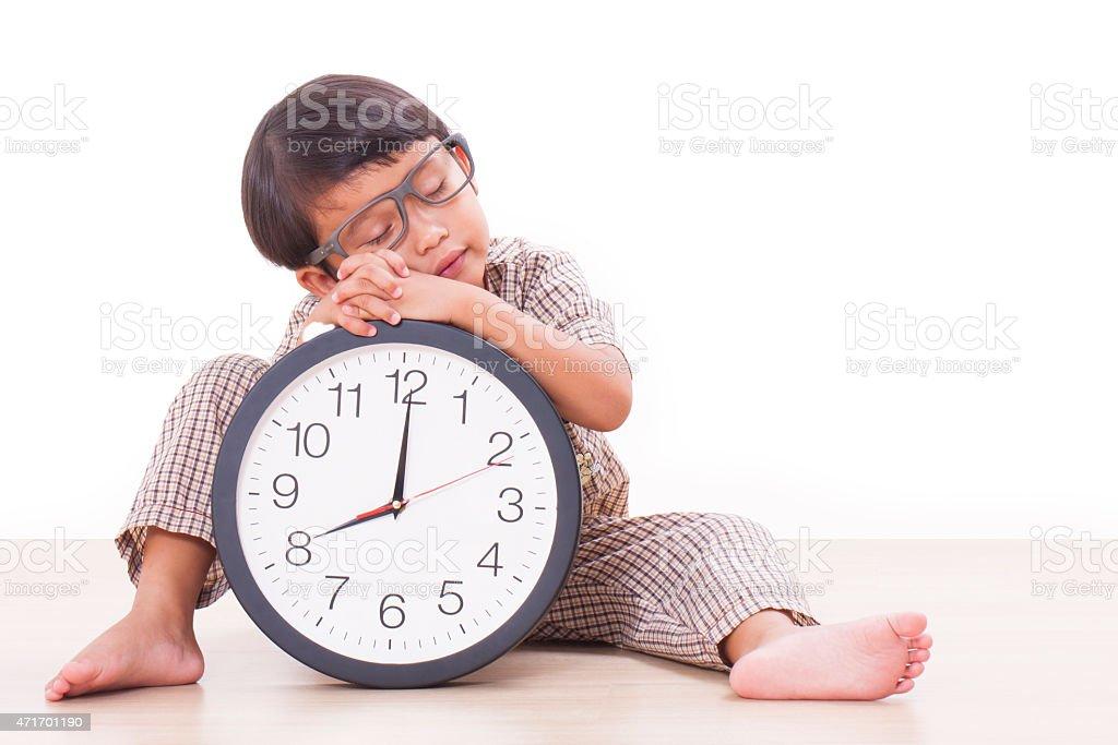 Cute boy is holding big clock stock photo