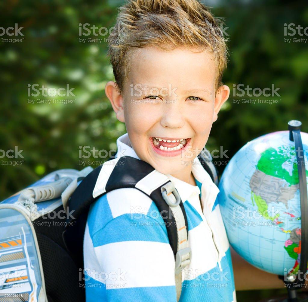 Cute boy is holding globe royaltyfri bildbanksbilder