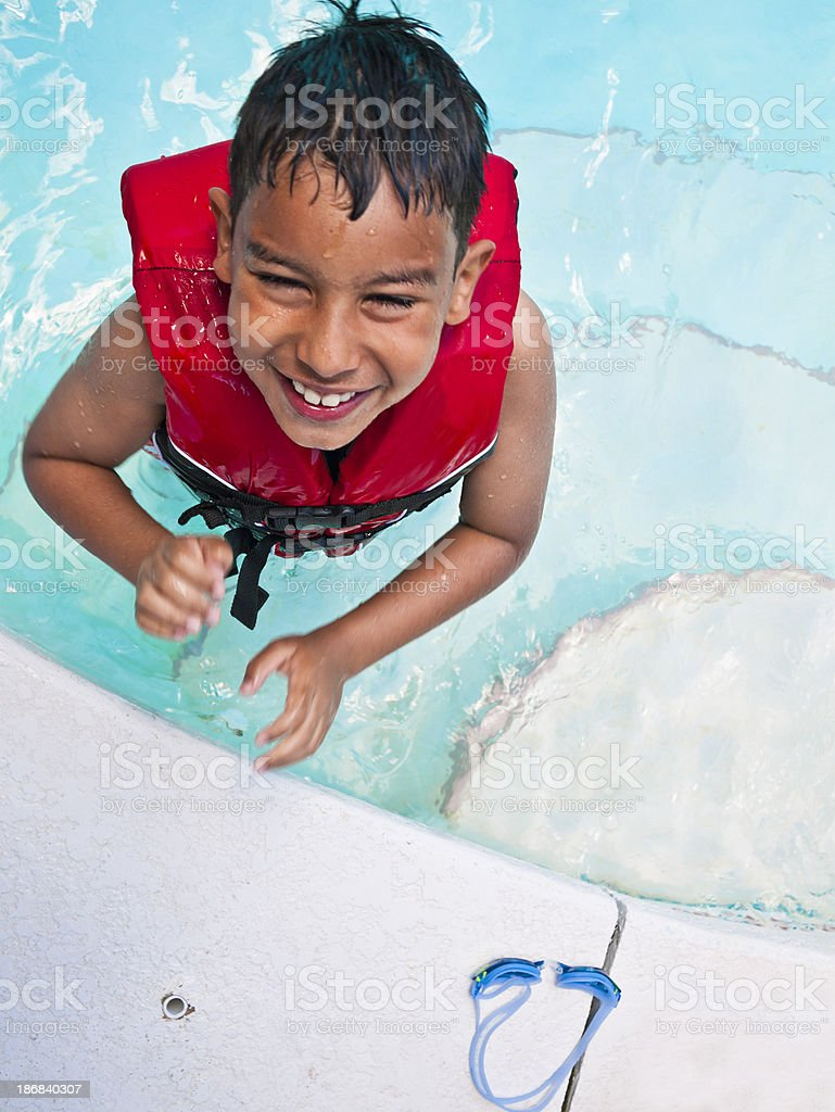 cute boy laughing in the pool royalty-free stock photo