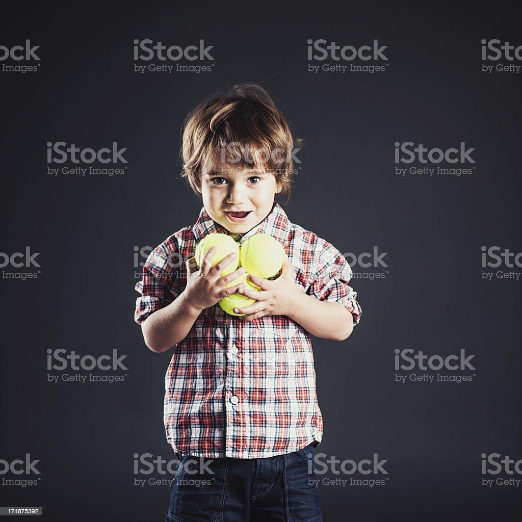 Cute boy looking into camera royalty-free stock photo