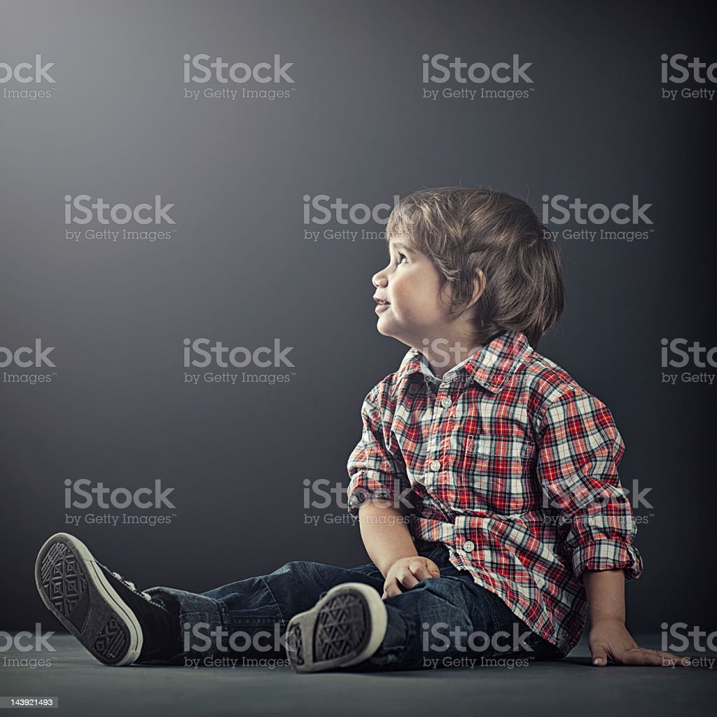 Cute boy looking into light stock photo