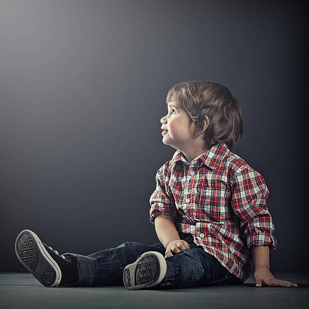 Cute boy looking into light stock photo
