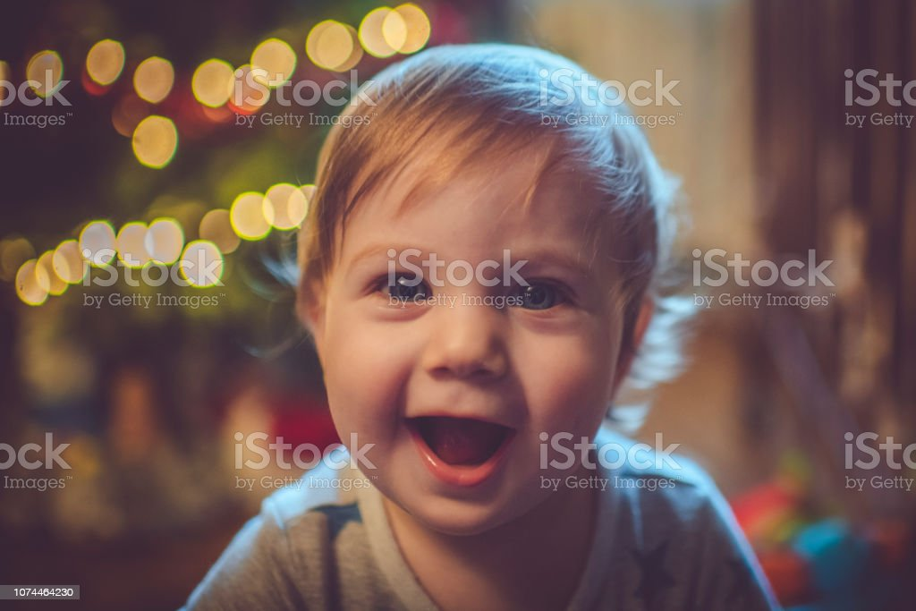 Cute boy near Christmas tree stock photo
