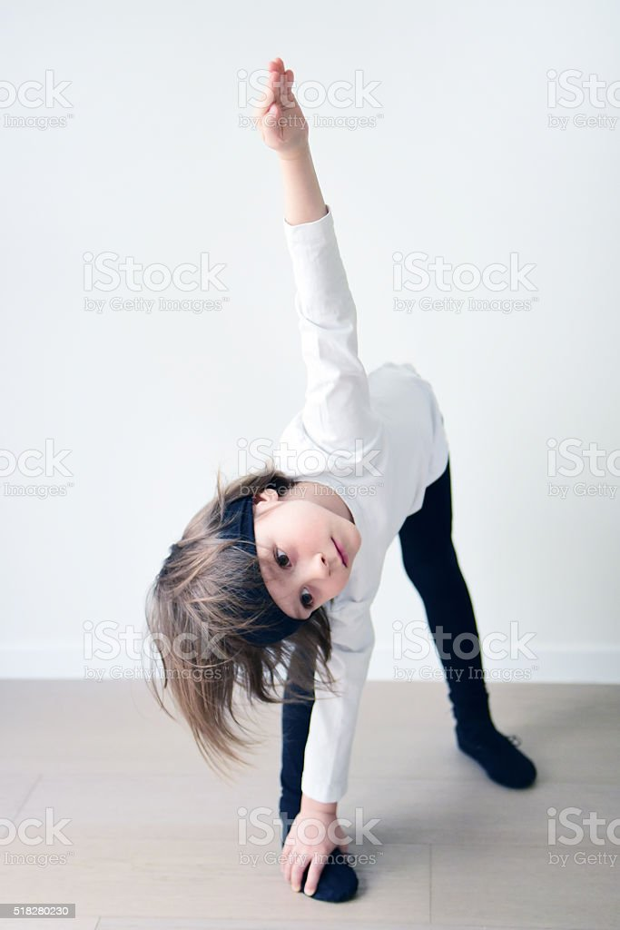 Cute boy of 5 years old practicing ballet stock photo