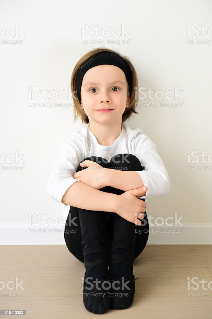 Cute boy of 5 years old rest after ballet practice stock photo