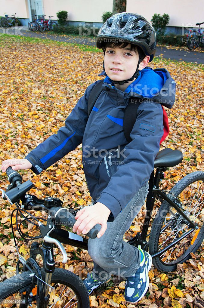 Cute boy on bicycle royalty-free stock photo