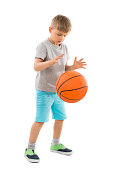 Cute Boy Playing Basketball Over White Background