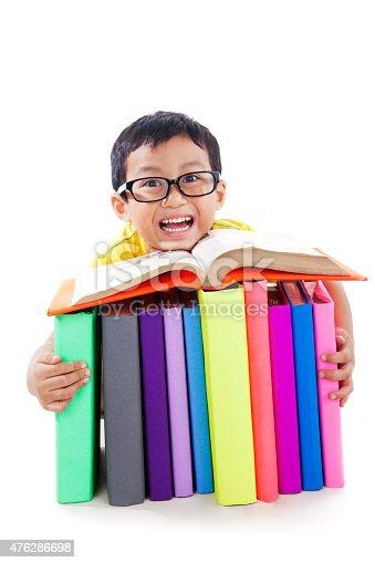 683105722 istock photo Cute boy reading book 476286698